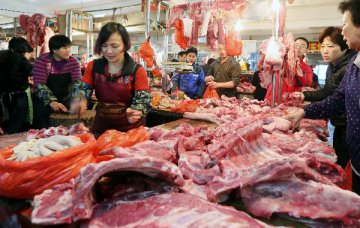 China warns pork food firms over African swine fever risks