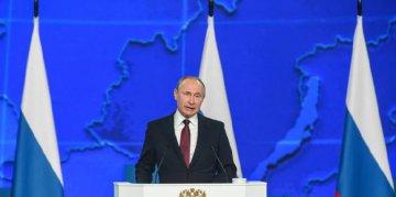 Putin pledges to increase social spending, strengthen defense