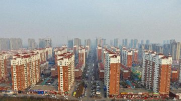 Chinese cities see slightly faster house price growth in March