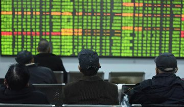 Chinese shares close lower at midday Monday
